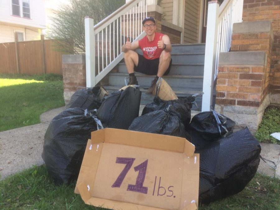 Jeremy Piper, co-founder of the new, UWO club Titan Students for a Cleaner Community, poses with garbage collected by students on and around campus.
