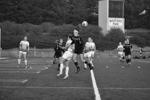 Sophomore Hannah Zacher heads a ball towards a teammate agaisnt UW-Platteville.