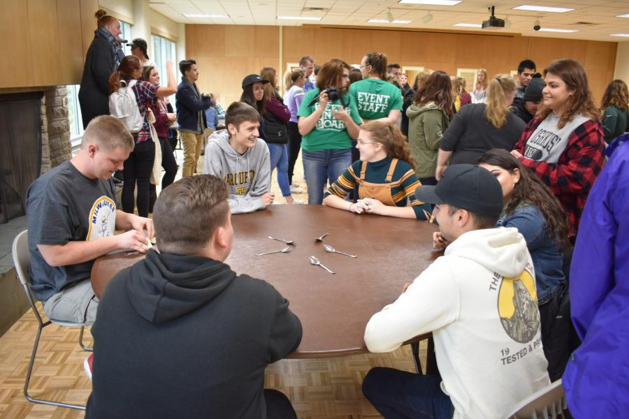 Students participate in a spoons competition.