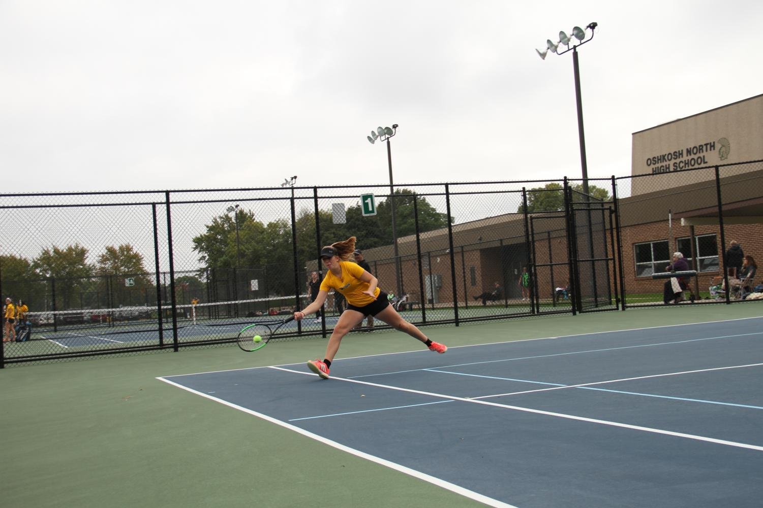 Junior Monica Micoliczyk reaches to return a ball hit by her opponent, UW-Whitewater's Elise Ha, on Tuesday.