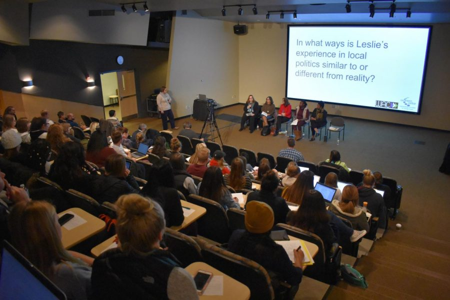 Students+take+notes+as+the+panel+discusses+women+in+politics+on+TV.