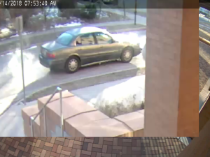 Pictured are images captured from video surveillance of the suspects and their get-away vehicle. No one was harmed during the robbery.