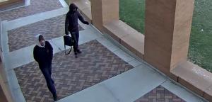 Video surveillance of suspects walking under covered sidewalk between horizon and reeve