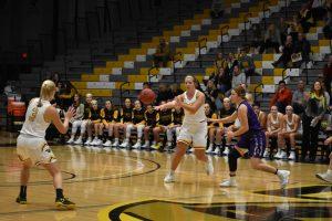 Sophomore Nikki Arneson passes the ball to freshman Brooke Freitag.
