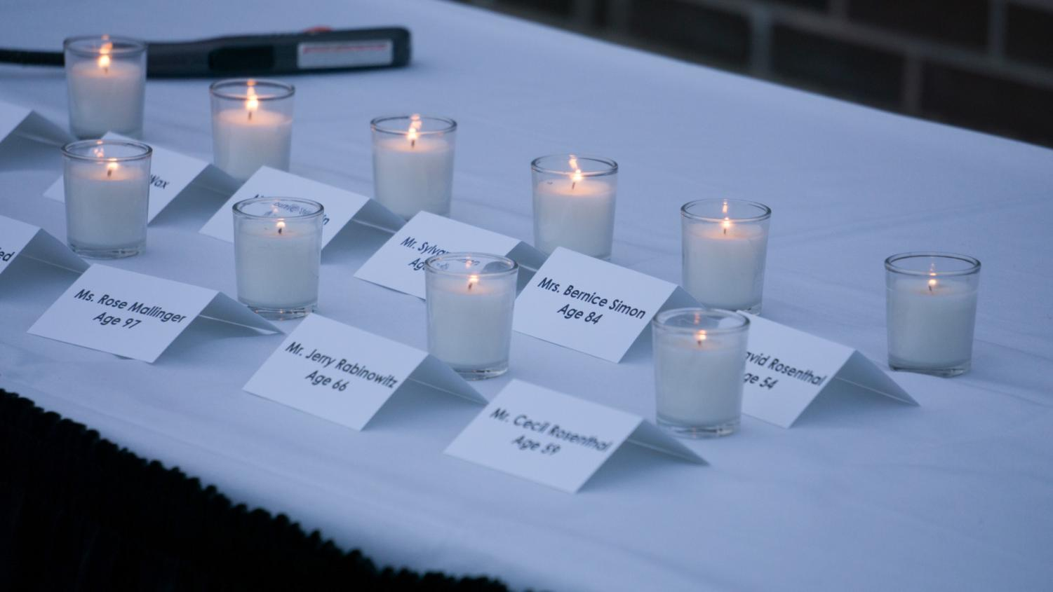 A candle is lit for each shooting victim.