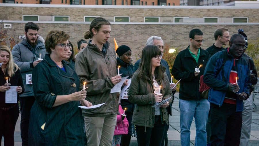 UWO students and community members honor the victims by joining together for a candlelight vigil.