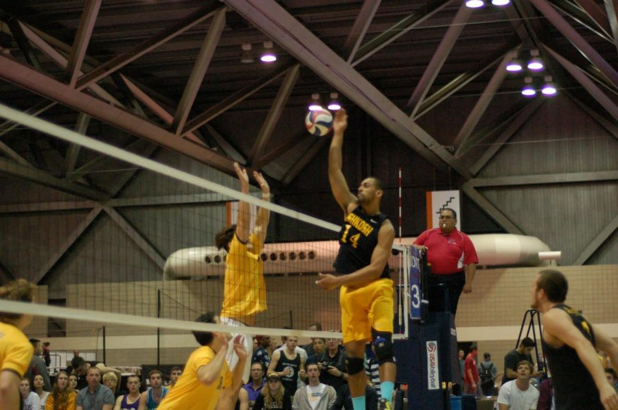 Travis Hudson rises above opponents to spike the ball. Hudson played at UW Oshkosh from 2013-17.