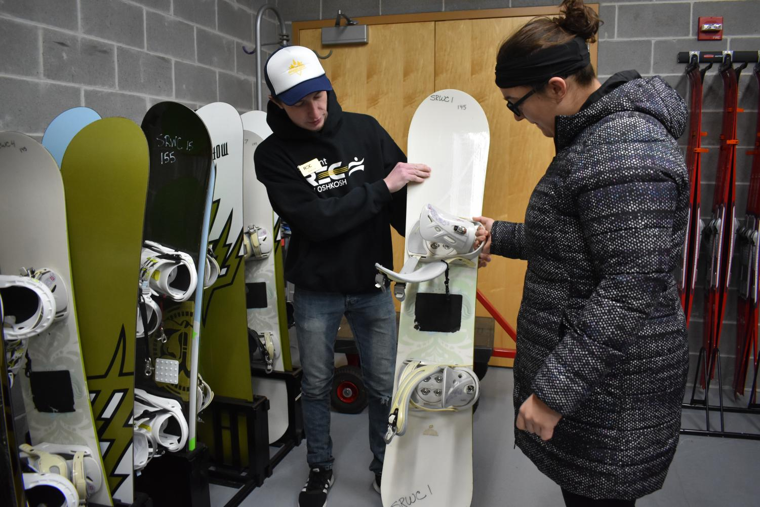 Students check out winter sports equipment including snow shoes and snowboards from the Student Recreation and Wellness Center.