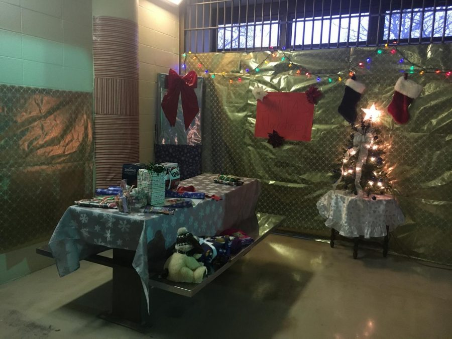 An old jail cell on the second floor of the public safety building was turned into Santa's Workshop, a donation space, by Crime Prevention Officer Kate Mann.