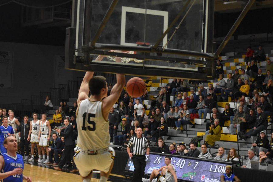 Junior Adam Fravert throws down an electric dunk against Finlandia University.