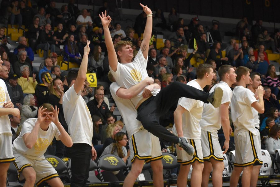 UWO%E2%80%99s+bench+celebrates+a+made+three+against+UWSP.+