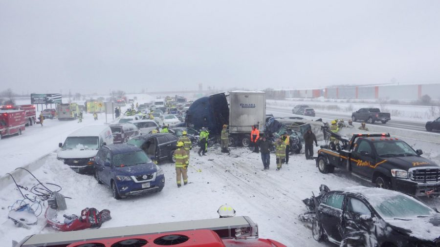 Firefighters+work+hard+to+get+people+out+of+their+vehicles+safely+and+to+clean+up+the+pieces+of+the+131+automobiles+involved.