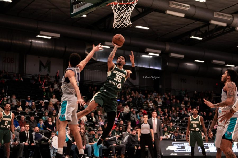 Christian Wood opts for a floater over a Greensboro Swarm player in the Herd's 105-107 loss at Menomonee Nation Arena. Wood finished with 19 points.