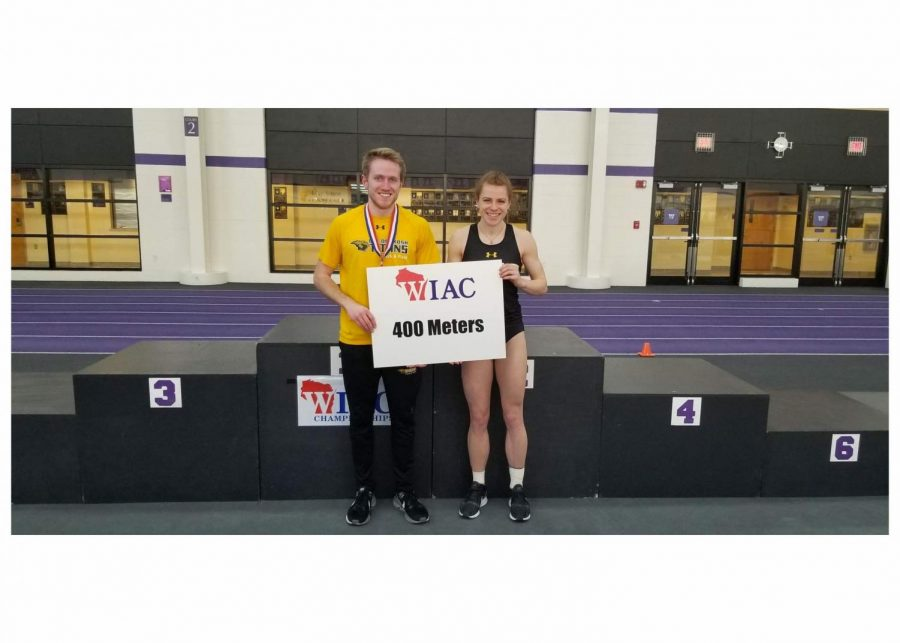 Seniors Ryan Powers and Lauren Wrensch pose after taking the crown in both 400-meter races at Whitewater.