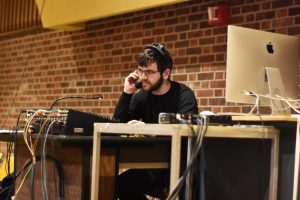 UWO senior Nathaniel Wolkoff as sound designer cues music.