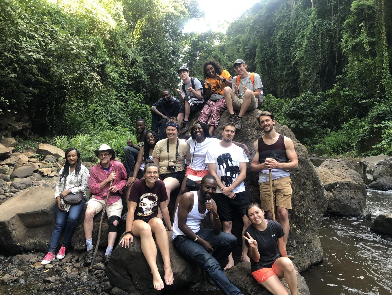 UWO student Katherine Pietrzykowski poses at Materuni Waterfall with her classmates in Tanzania.