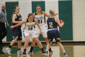 Falcons No. 10 Camryn Garriety and No. 21 Cassidy Williams defend offensive possession.