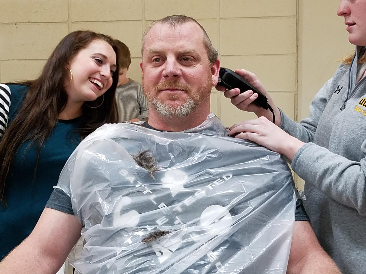 UWO swim and dive head coach Christopher Culp gets his head shaved to fulfill the bet he made with his team after they set numerous school records at the WIAC Championship last weekend. Culp told his team to get five records, they set ten.