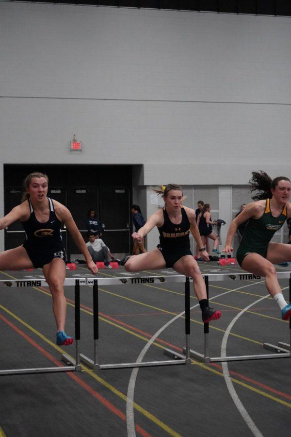 UWO Sadie Huth sprints through the first set of hurdles in the 60-meter dash.