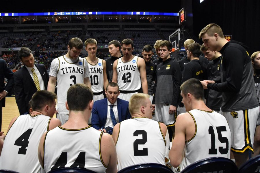 Titan head coach Matt Lewis talks to his starters during a timeout at Allen County War Memorial Coliseum in Fort Wayne, Indiana. With the win, the Titans advance to play Swarthmore College in the NCAA Division III Men's Basketball National Championship Game.