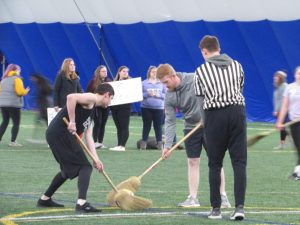 Students compete in Broomball, a sport similar to hockey.