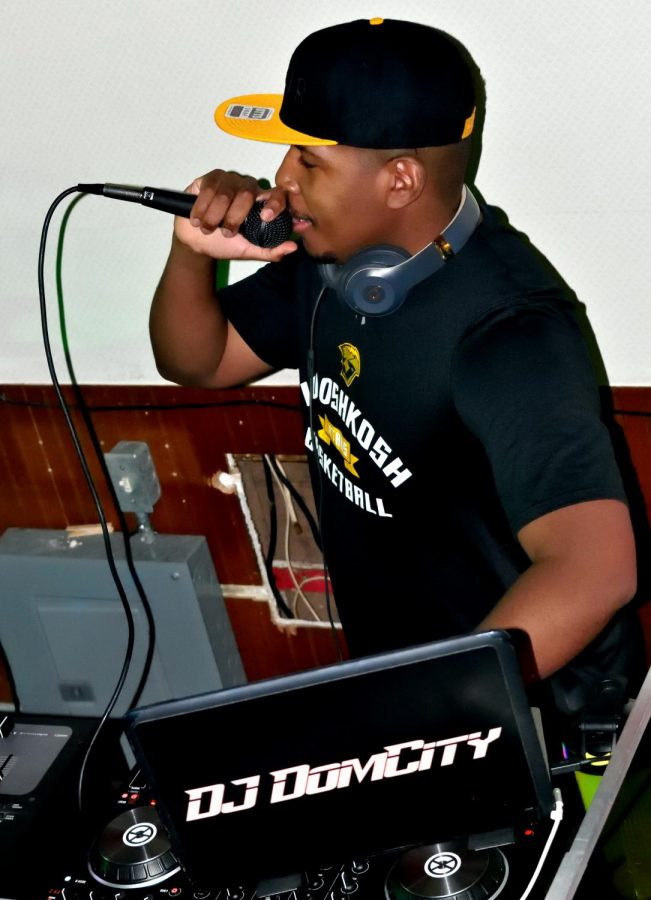 DJ Dom City speaks into the mic at Molly's
