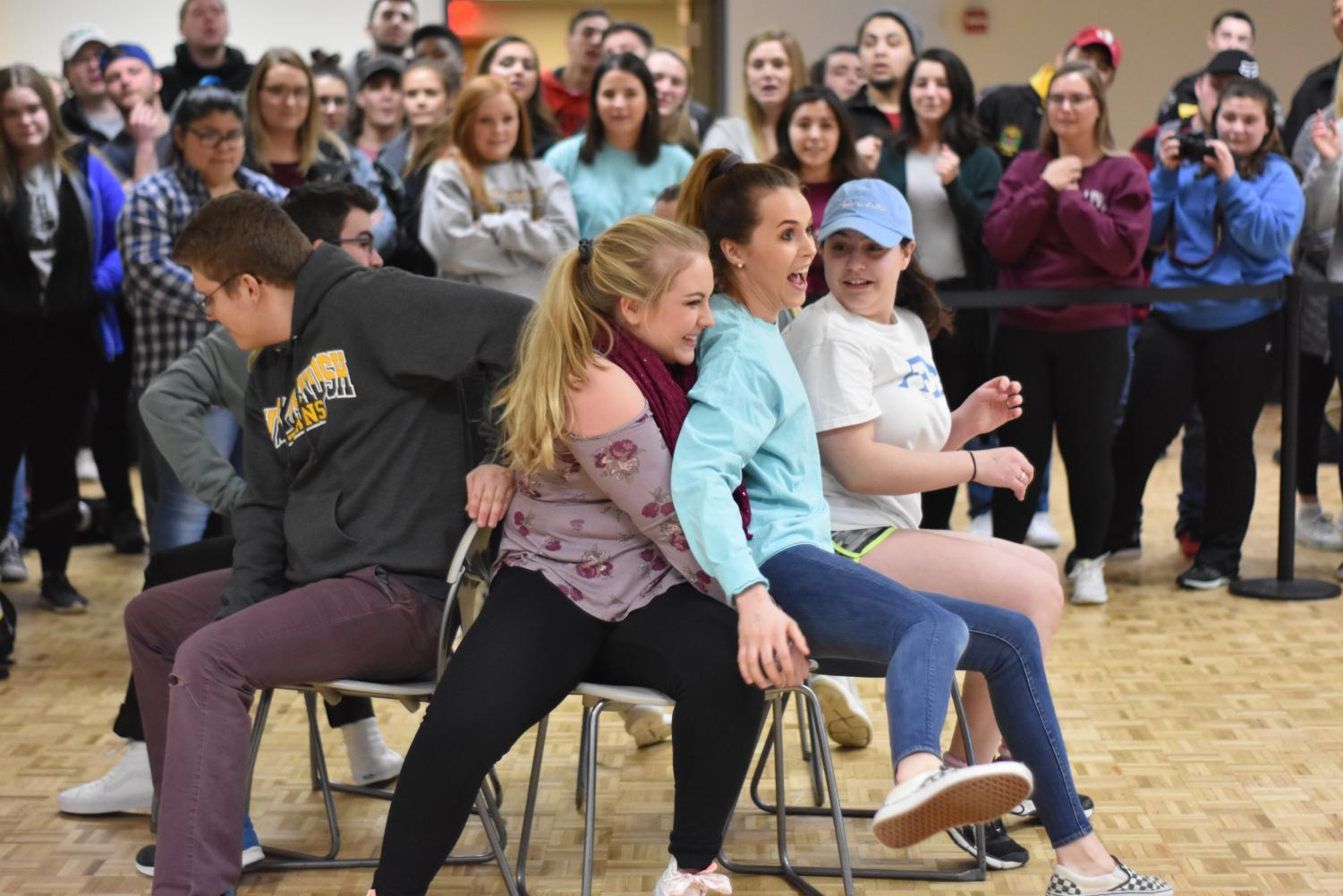 Students particpate in musical chairs during the 2019 Winter Carnival, aimed to engage students.