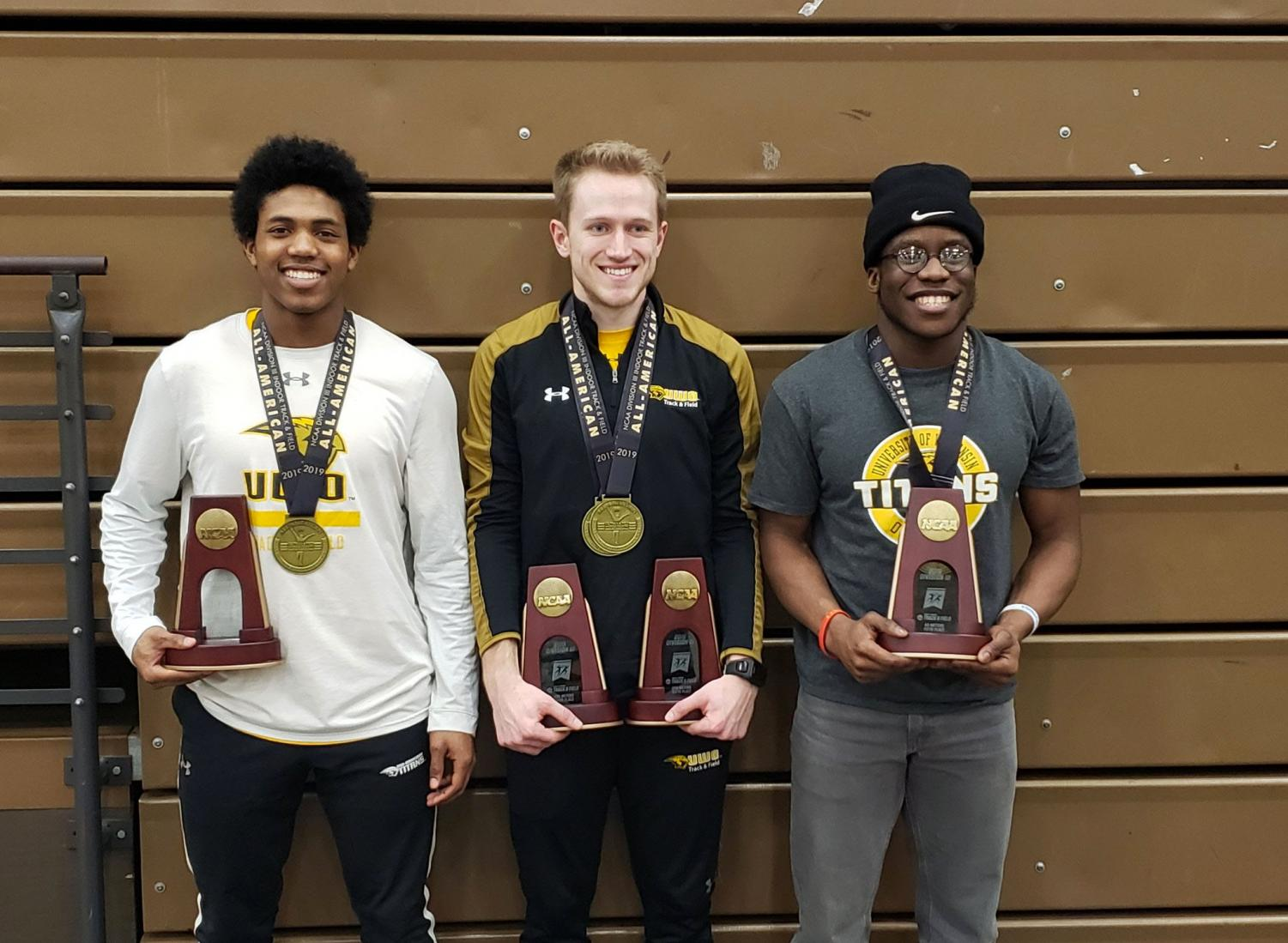 FROM LEFT TO RIGHT: Freshman Johnathan Wilburn, senior Ryan Powers and sophomore Robert Ogbuli pose with their All-American recognition medals and event trophies.