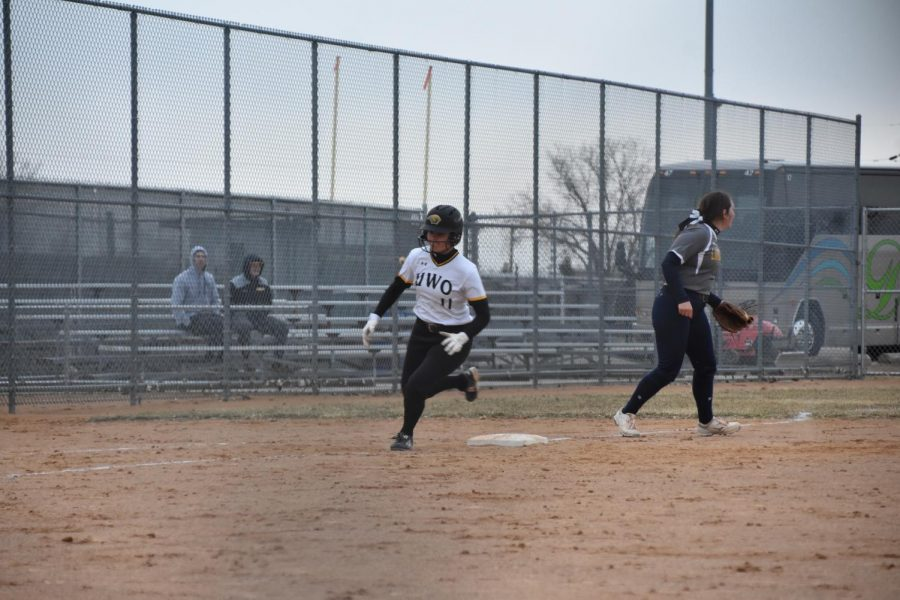 Titan sophomore Carly Szada runs home off of Claire Petrus' double to left center field late in the sixth.