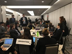 group of MUN students sits around a table discussing topic issues