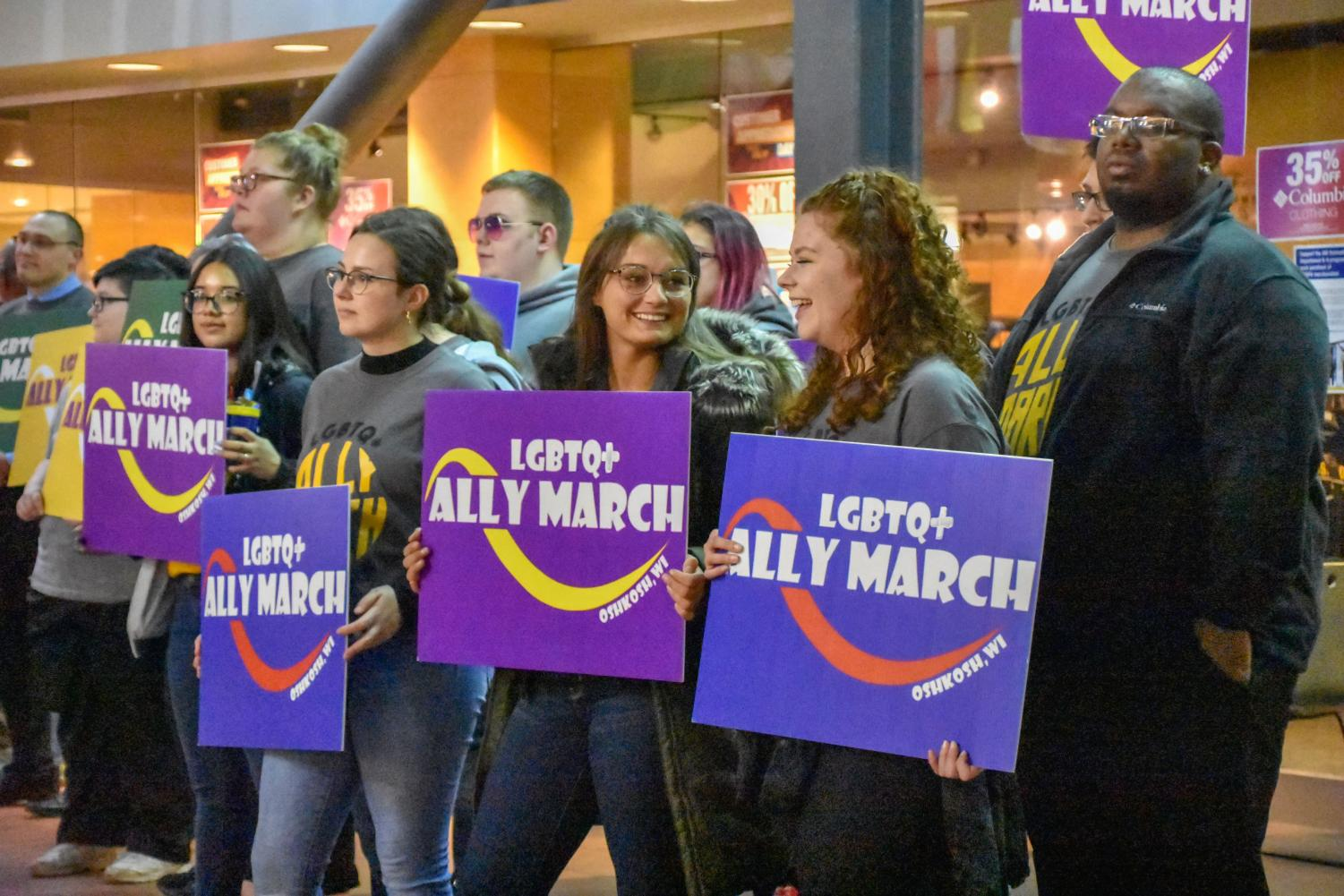 UWO students and staff participate in the 10th annual LGBTQ+ Ally March by holding a silent march in Reeve Memorial Union due to inclimate weather.