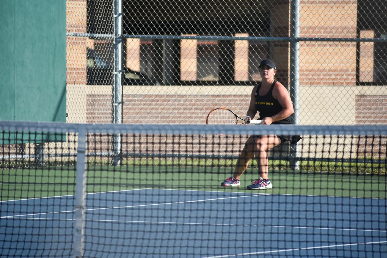 Junior Samantha Koppa stands waiting for a return. Koppa won her doubles match 8-2.