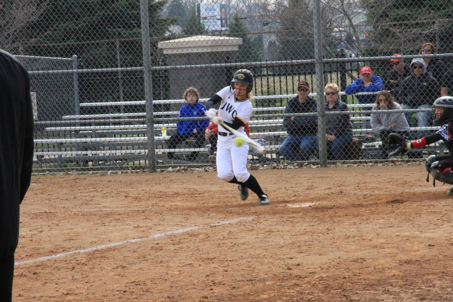 Smaney connects at the plate during doubleheader against the Red Hawks.