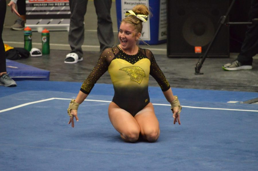 Freshman+Emily+Gilot+poses+during+her+floor+exercise+which+won+her+an+All-American+Honor.