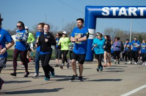 unners participate in mental health awareness run