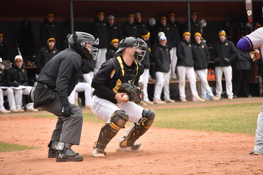 Catcher Jensen Hinton checks a runner on base during their game against UW-Stevens Point earlier this season.