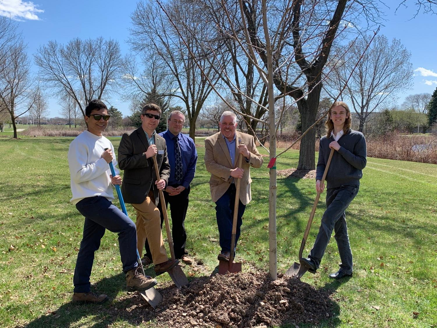 Pictured (left to right): Gilberto Castaneda, UWFDL student; Brian Kolstad, president, FDL City Council; Martin Rudd, vice chancellor, UWFDL and UWFV; Brendan Stormo, past-president, FDL Morning Rotary; and Erik Janssen, UWFDL student plant trees.