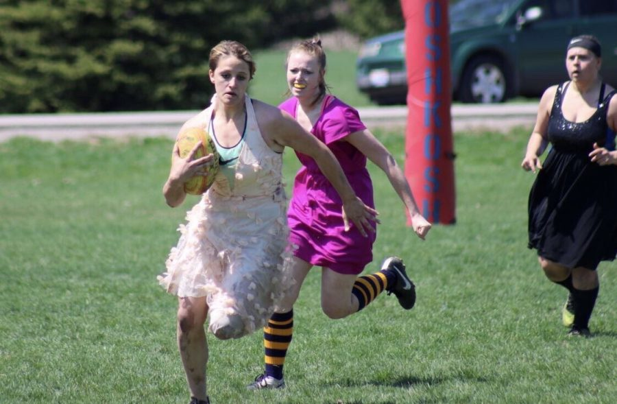 Rugby players playing in prom dresses