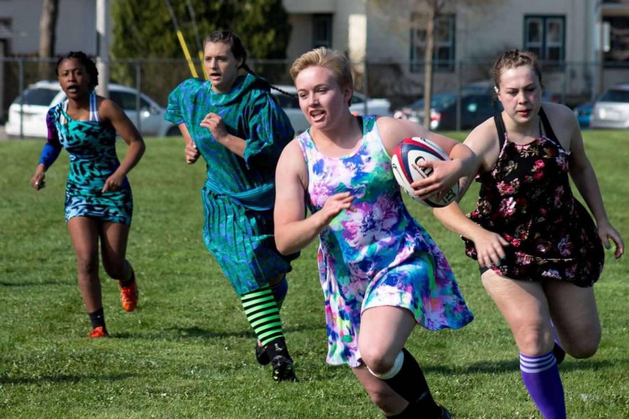 UWO Women's Rugby hosts promball, players play in dresses of all styles.