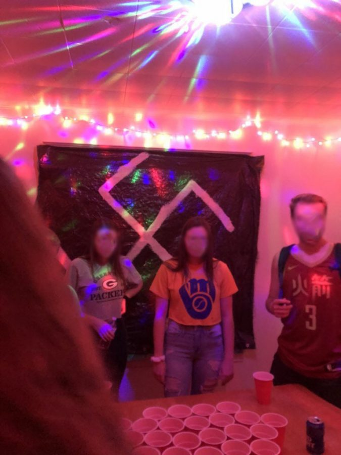 Flag bearing swastika hangs in a student house bordered by string lights