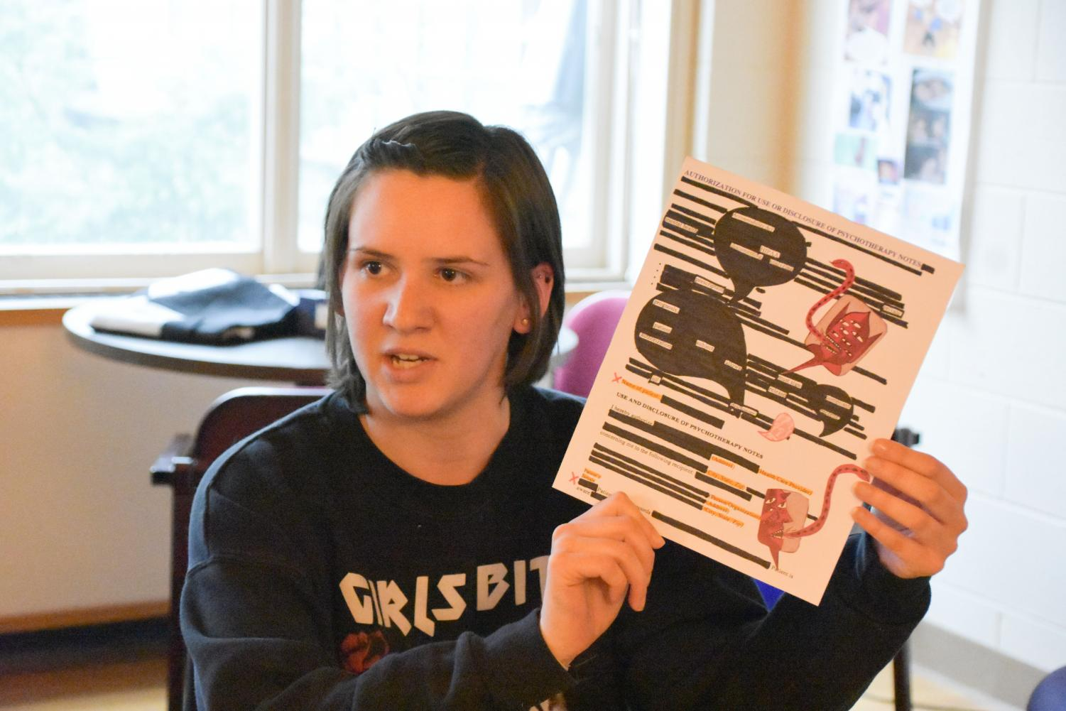 UWO alumna Brooke Berrens participates in blackout poetry for reproductive rights on Thursday.