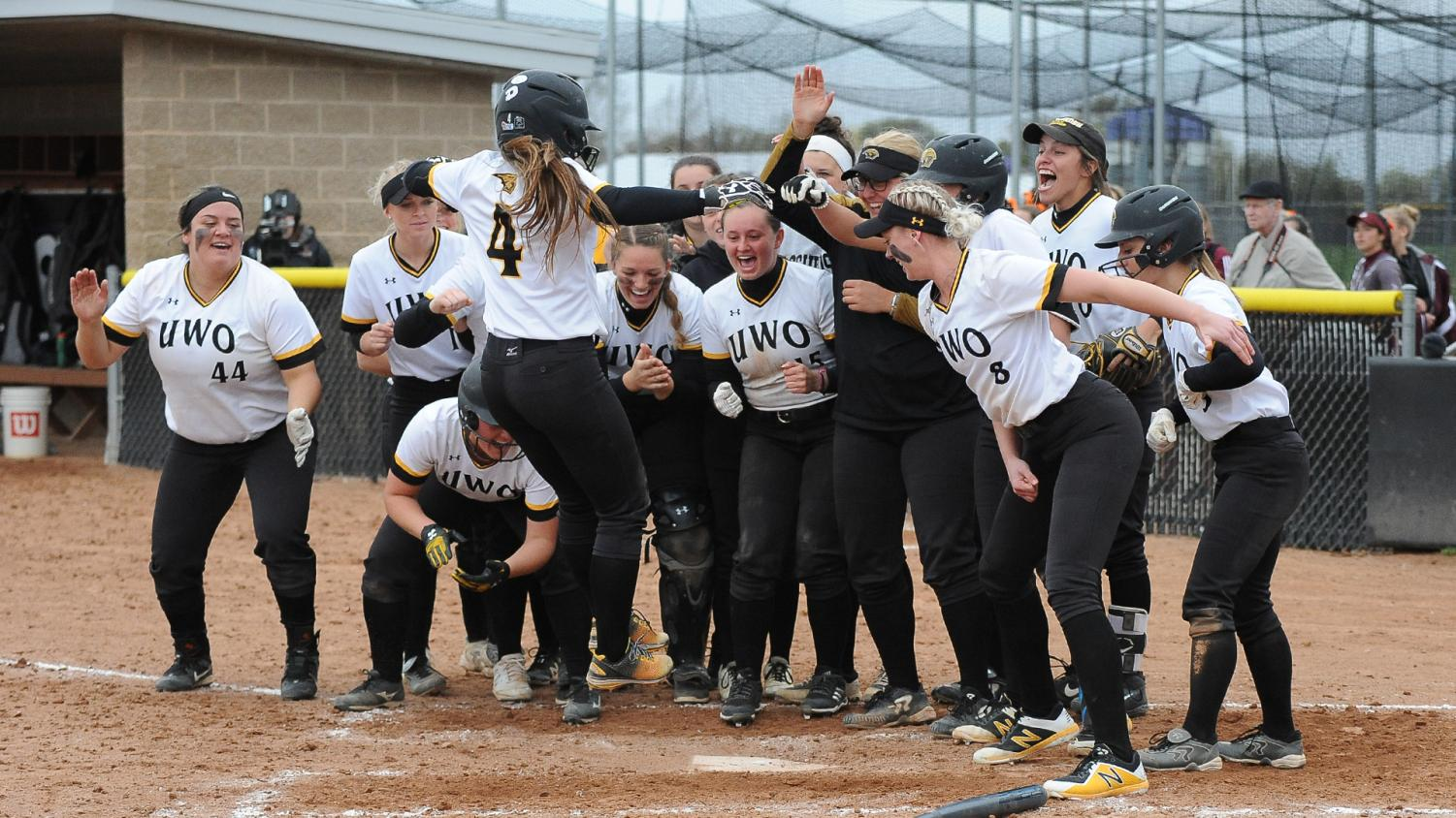 Kailee Garstecki's surrounded by her teammates following her two-run homerun versus the Warhawks. The team finished the year with a 23-17 record.