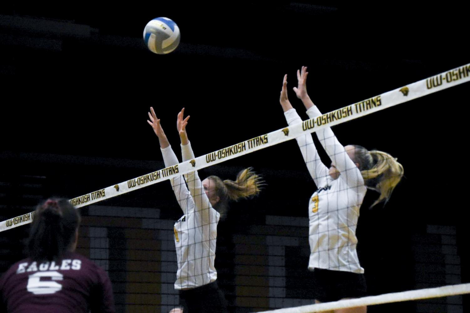 Junior Shelby Coron and freshman Carissa Sundholm leaped to block a La Crosse kill attempt on their game last Wednesday.
