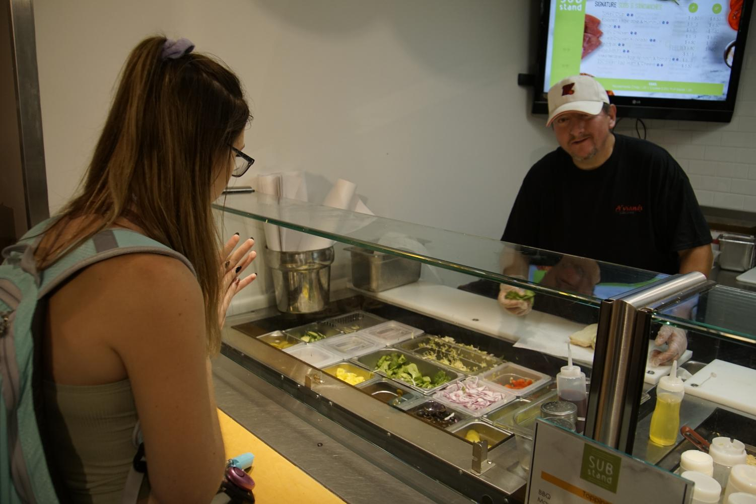 "An A'viands employee makes a sub for a UW Oshkosh student at the newly named ""Sub Stand"" at Reeve Union."
