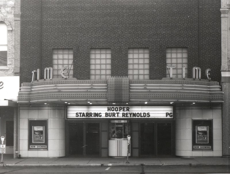 "The Time Theater advertises a showing of ""Hooper,"" starring Burt Reynolds, released in July 1978."