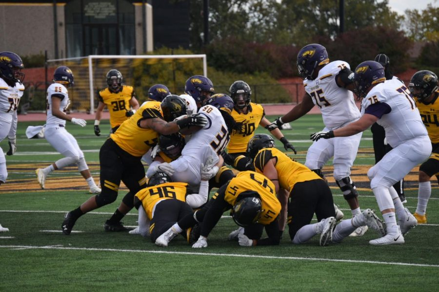 A host of UW Oshkosh defenders tackle UWSP running back ShamaJ Williams during the Titans' 20-7 victory on Saturday.  UWO will face UW-Eau Claire next game in the team's homecoming game.