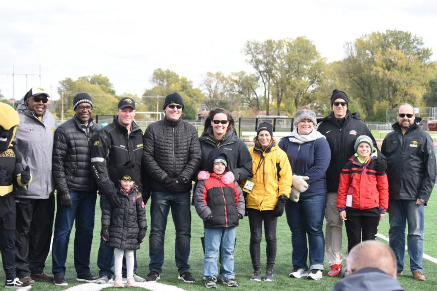 The+2019+Titan+athletics+Hall+of+Fame+inductees+stand+on+the+field+at+Titan+Stadium+with+Athletic+Director+Darryl+Sims+and+Chancellor+Andrew+Leavitt+on+Saturday.