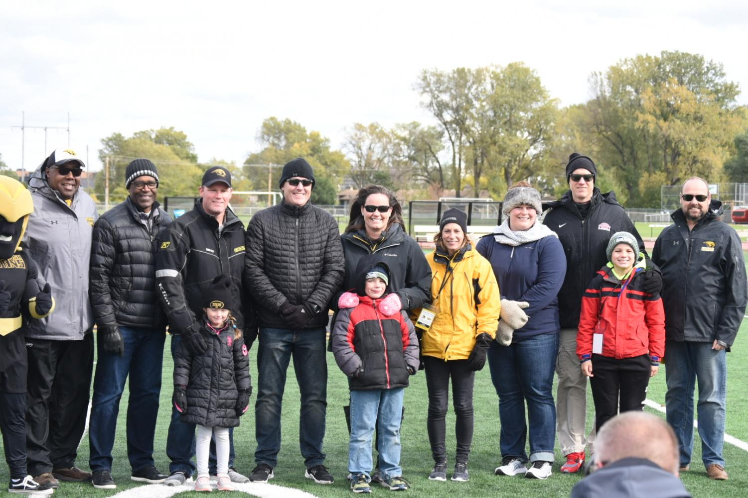 The 2019 Titan athletics Hall of Fame inductees stand on the field at Titan Stadium with Athletic Director Darryl Sims and Chancellor Andrew Leavitt on Saturday.
