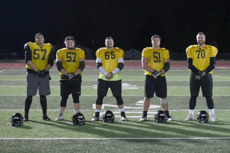 The UWO linemen pose for a picture