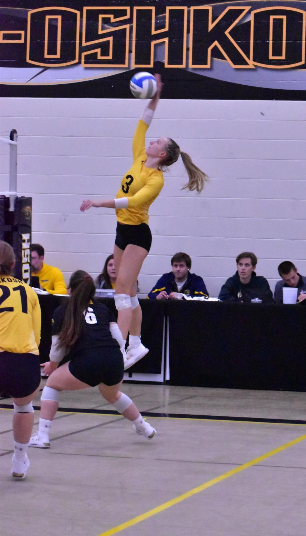 Senior Carissa Sundholm rises up to slam a kill over the net.
